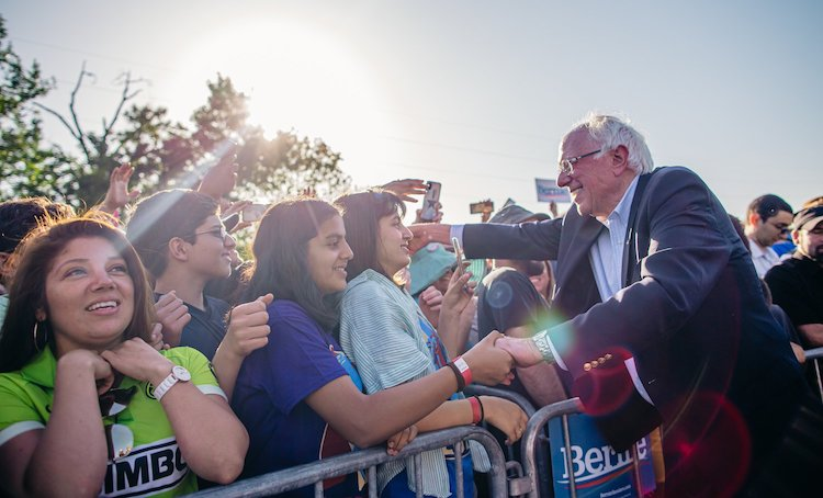 Photo: Bernie Sanders at an election campaign in March 2020, emphasizing the need for a welcoming and Safe America for All. Credit: Bernie Sanders' Official Campaign Website erniesanders.com