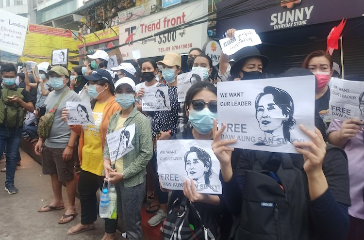 "Photo: Protesters in Yangon carrying signs reading ""Free Daw Aung San Suu Kyi"" on 8 February 2021. CC BY-SA 4.0"