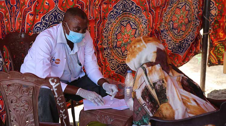 Photo: A woman receives health services at a transit point in Hamdayet. Credit: UNFPA Sudan/Sufian Abdul-Mouty.