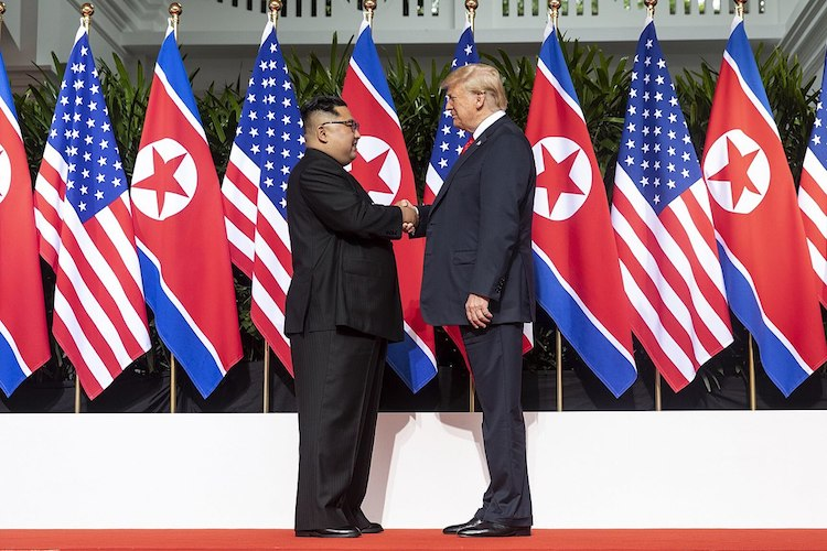 Photo: Kim and Trump shaking hands at the red carpet during the DPRK-USA Singapore Summit on June 12, 2018. Credit: Wikimedia Commons.