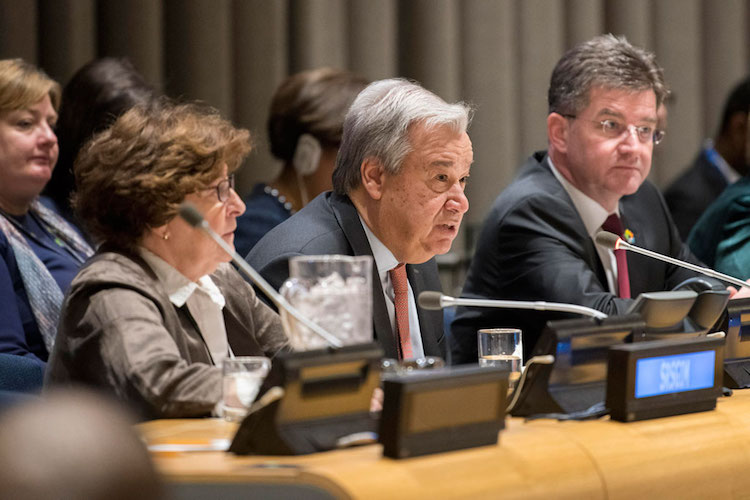 "Photo: Secretary-General António Guterres (centre) delivers his report entitled ""Making Migration Work for All"" to the UN General Assembly on 11 January 2017. Credit: UN Photo/Mark Garten"