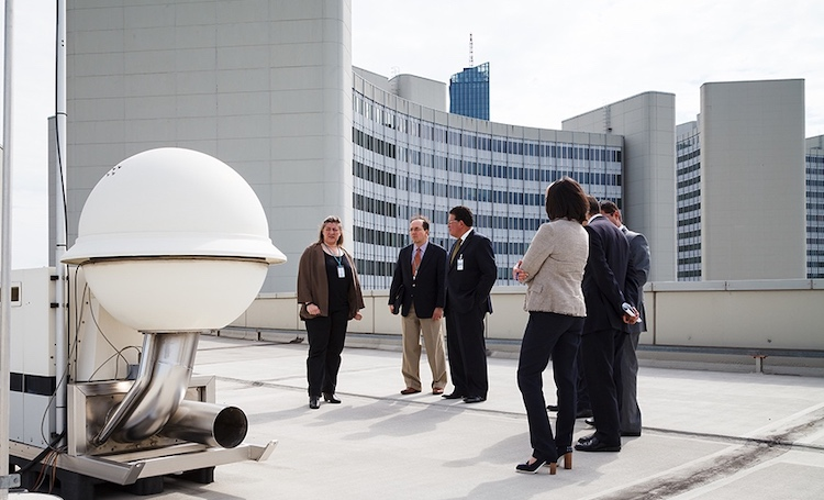 Photo: Officials examine a radionuclide detector stationed on the roof of the Vienna International Centre, home of CTBTO headquarters. Russia has deployed seven such detectors on its territory as part of the CTBTO's monitoring system, but some stopped transmitting information after a Russian weapons accident on August 8. Credit: CTBTO