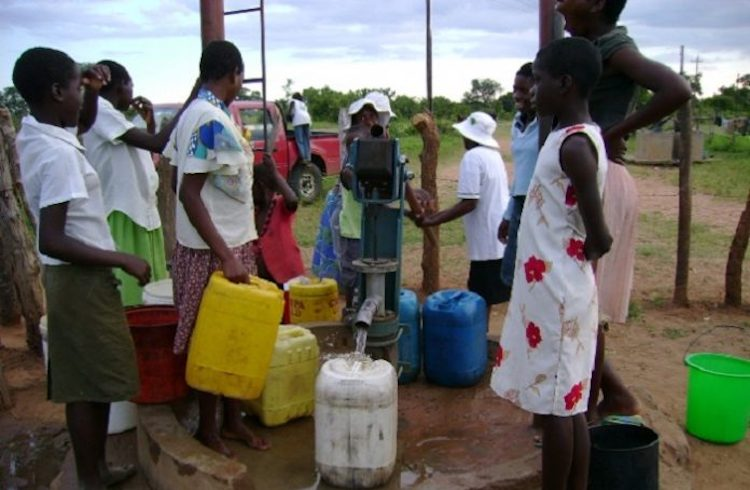 Photo: People at a borehole, one of the groundwater sources people have turned to in Zimbabwe's towns and cities as climate change impacts bite. Credit: Construction Review Online.