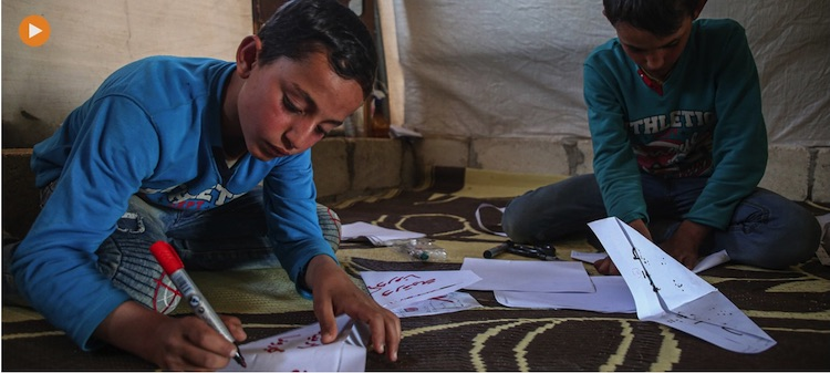 Photo: Two boys making paper masks at the Al-Tah IDP camp in Idlib Governorate, Syria. Credit: United Nations