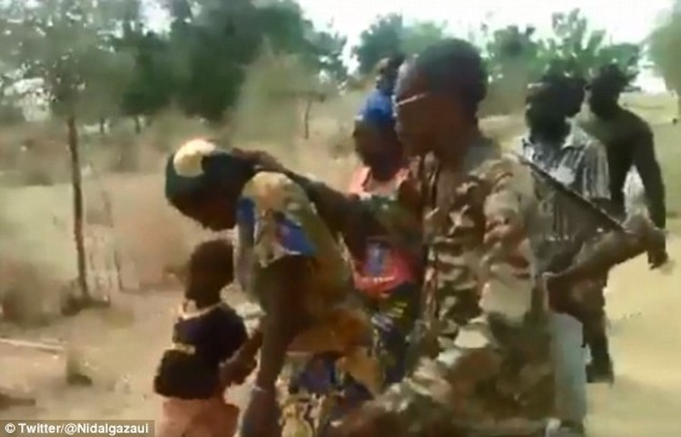 Photo: A horrific video circulating online appears to show women and children being blindfolded and executed at point blank range in Cameroon.