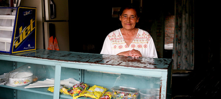 Photo: A seasonal worker at a store in Buga, Colombia. Credit: World Bank/Charlotte Kesl.