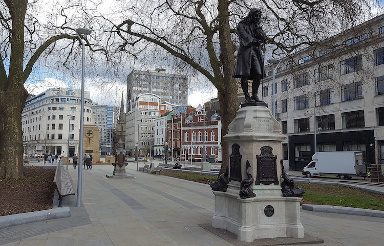Photo: Northern end of The Centre, Bristol, showing Cenotaph and statue of slave trader Edward Colston following MetroBus-fCC BY-SA 4.0 under public realm improvements, March 2018. Source: Wikimedia Commons.