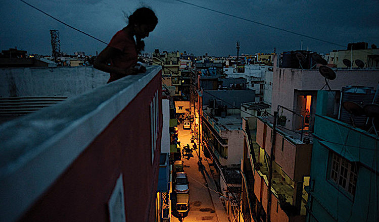 Photo: Girl on roof of a factory in India. Source: UNFPA © Andrea Bruce/Noor