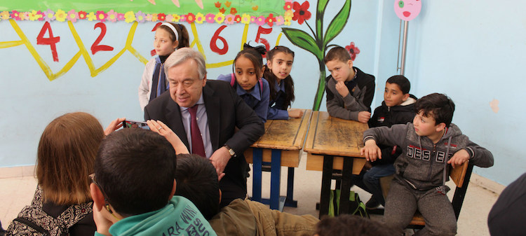 Photo: Secretary-General António Guterres is photographed by a student during a visit to a school run by the UN Relief and Works Agency for Palestine Refugees in the Near East (UNRWA) at Baqa'a Camp in Jordan. Credit: UN