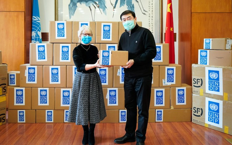 Photo: Handover ceremony at UN compound in Beijing for donation of critical medical supplies to the Chinese government. Credit: UNDP China