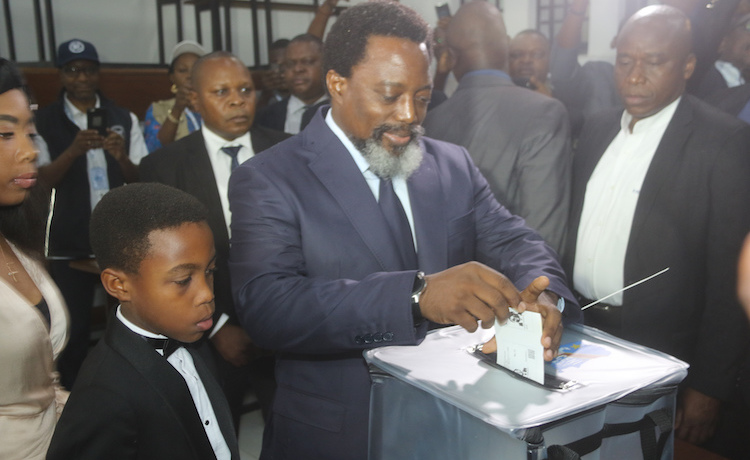 Photo: DR Congo President Kabila casts his vote during Presidential and Legislative elections in Kinshasa. Credit: MONUSCO/John Bopengo.