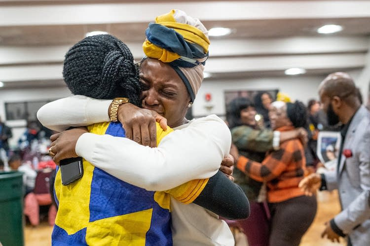 Photo: Denise Butler (right) embraced Nelima Sitati Munene on January 4 in Brooklyn Park as they celebrated a new federal law giving Liberians in the U.S. a path to citizenship. Credit: Evan Frost | MPR News