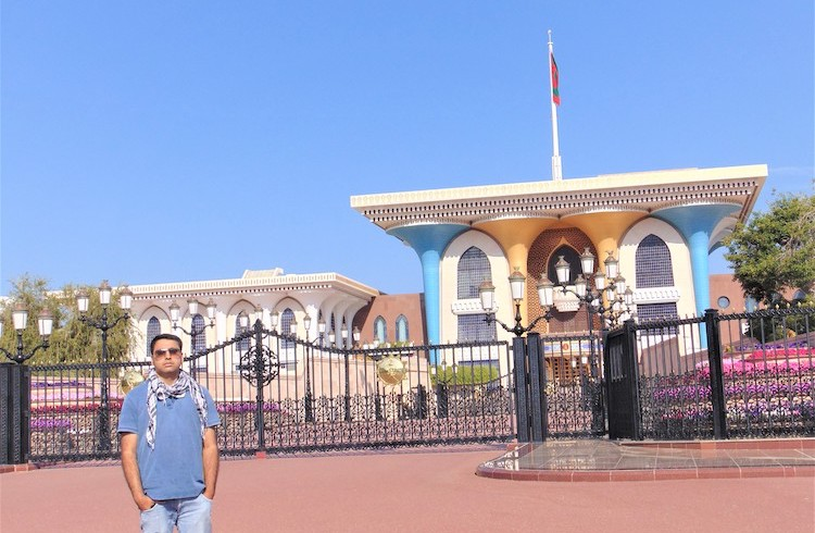 Photo: The writer in front of the Sultan's Al Alam Palace in Old Muscat. Credit: Manish Rai.