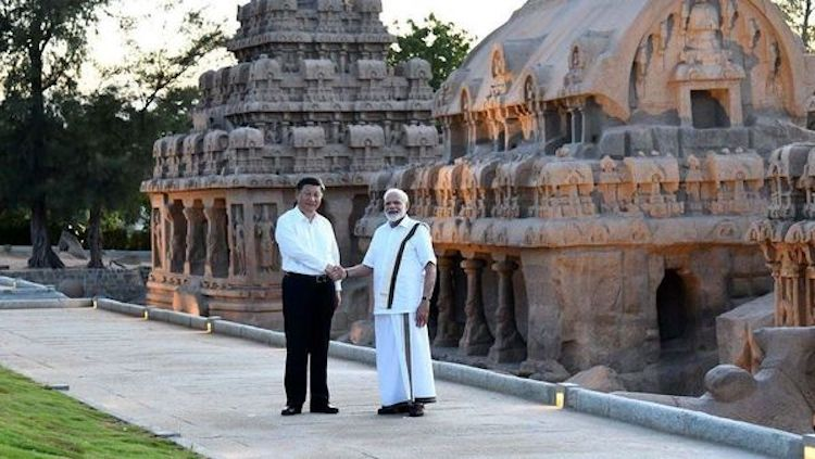 Photo: Chinese President Xi Jinping shaking hands with Indian Prime Minister Narendra Modi at Mamallapuram, a World Heritage Site in the south Indian state of Tamil Nadu. Courtesy: Press Information Bureau, Government of India.