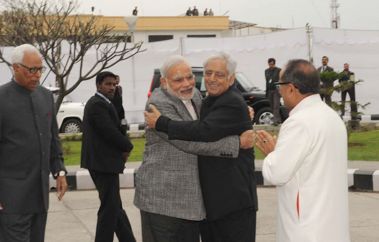 Photo: Prime Minister Narendra Modi arrives at the swearing-in ceremony of Mufti Mohammad Sayeed as Jammu&Kashmir Chief Minister, at Jammu University, in Jammu and Kashmir on March 1, 2015. The J&K Governor N.N. Vohra is also seen. Credit: India Prime Minister's Office.