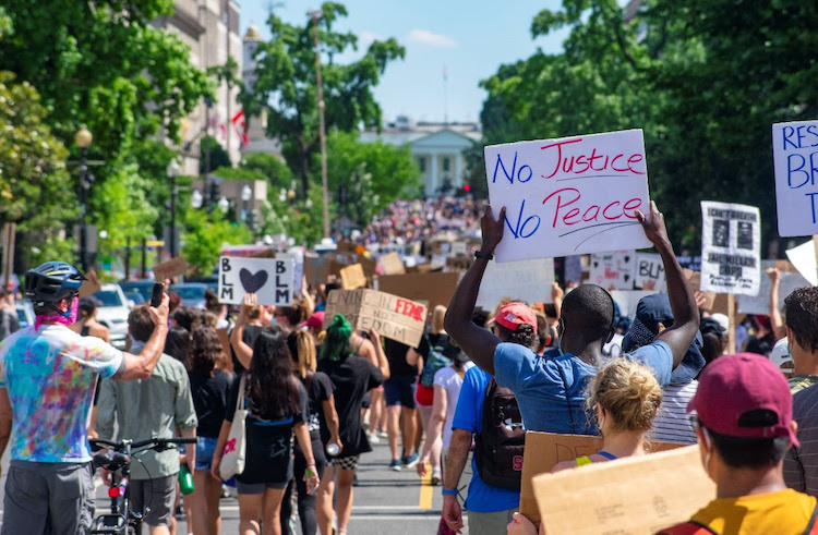 "Photo: Thousands of protestors march on newly named ""Black Lives Matter Plaza"" in Downtown DC on June 7."