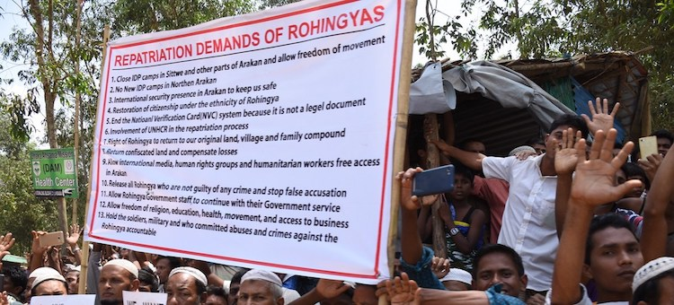 Photo: Rohingya refugees in Kutupalong settlement in Cox's Bazar, Bangladesh, hold a sign demanding their repatriation to their homeland in Myanmar. Credit: Caroline Gluck/UNHCR