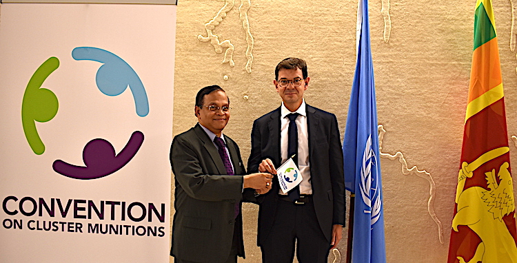 Photo: On 4 September 2019, Ambassador A.L.A. Azeez, Sri Lanka's Permanent Representative to the UN in Geneva who presided over the 9th MSP, handed over the Presidency of the Convention on Cluster Munitions to Ambassador Félix Baumann, Permanent Representative of Switzerland to the Conference on Disarmament as the President of the Second Review Conference. Credit: The Convention on Cluster Munitions.