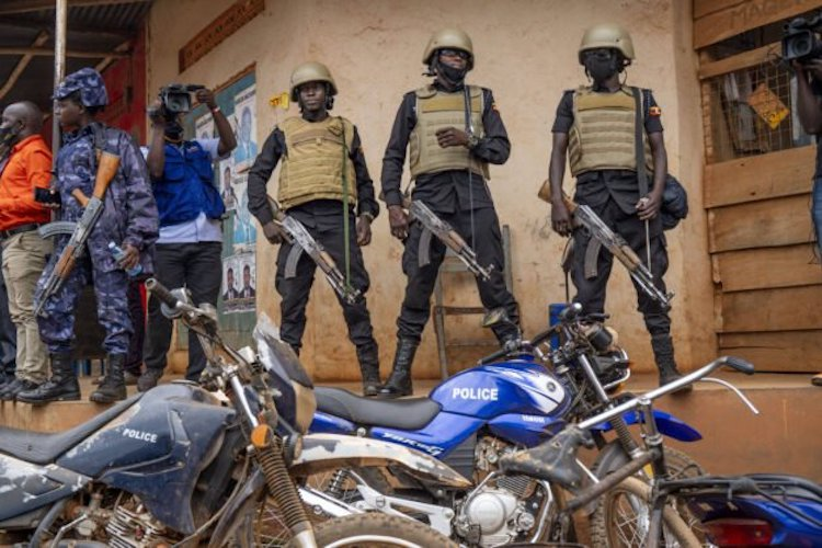 Photo: Security forces stand outside a polling station in Kampala, Uganda, on January 14, 2021. Source: The African Report.