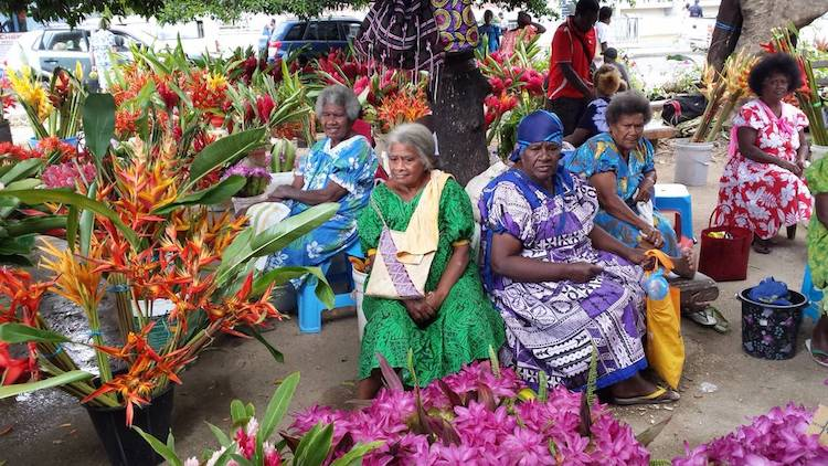 Photo: Women at the main fruit, flower and vegetable market in Vanuatu's capital, Port Villa. ©FAO/Zarfia Amoa