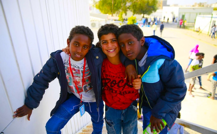 Photo: Three young children wait to be evacuated from Libya to Niger, at UNHCR's Gathering and Departure Facility in Tripoli. © UNHCR/Mohamed Alalem